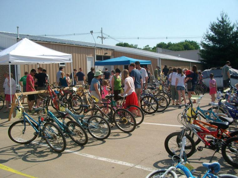 Visitors view the bikes for sale at the Community Used Bike Sale in 2013 hosted by the Champaign Cycle Co.