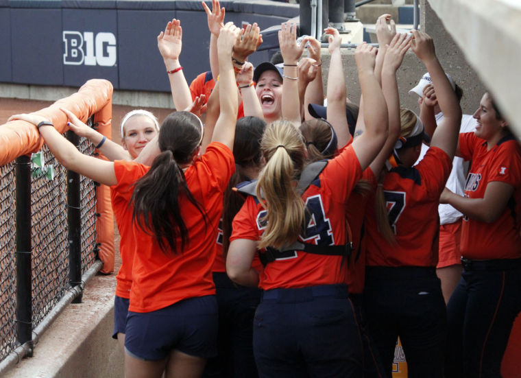 The Illinois softball team cheers after a hit by Allie Bauch (not pictured) during the second game against Michigan at Eichelberger Field on April 26. The Illini lost 6-5.