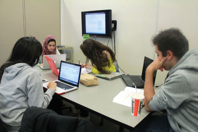 Noor Qaddour, freshman in LAS, Lina Al-Chaar, sophomore in LAS, Ahmad Hamdan, senior in Engineering, and Arsheen Aziz, senior in LAS, use the Media Commons in the Undergraduate Library for group research. The Media Commons was new to the UGL for spring 2013 and helps students utilize technology with their school work.
