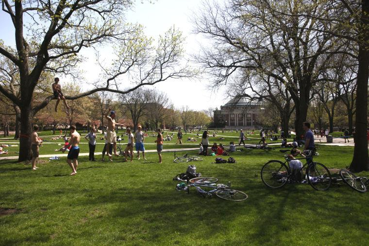 Students sit, bike and play games, filling the Quad on a warm afternoon on April 30.