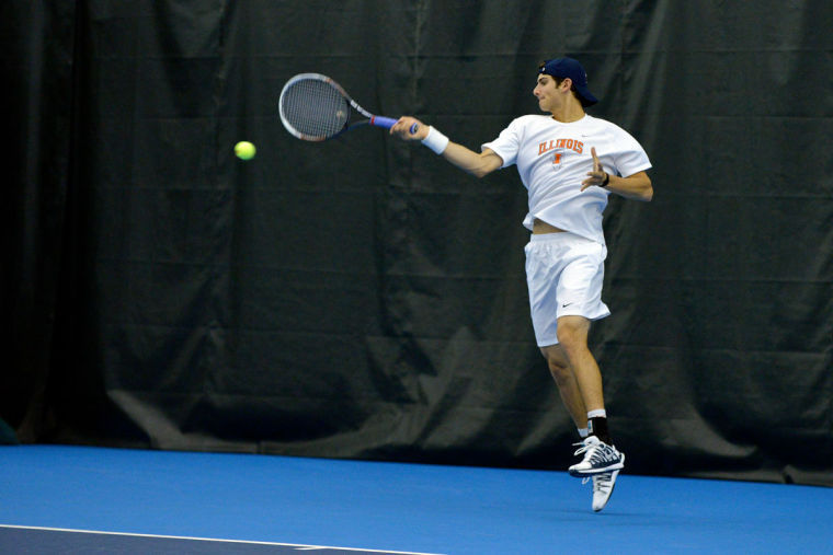 Illinois' Jared Hiltzik hits the ball during a match against Texas on Feb. 9.