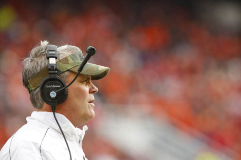 Illinois' Tim Beckman watches a game at Memorial Stadium. Beckman has received criticism for his 6-18 record, and pressures mount for this next season to show some wins.
