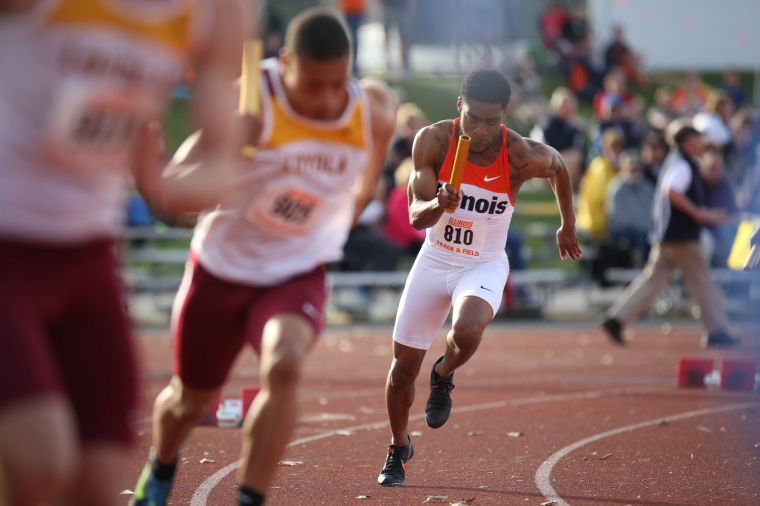Illinois' Julian Smith starts the 4x100 meter relay during the Illinois Twilight Track and Field meet at Illinois Soccer and Track Stadium on April 12.