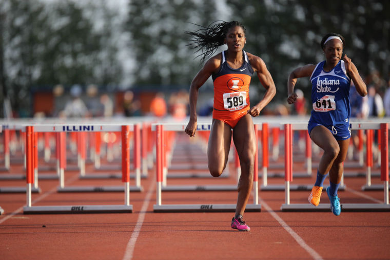 Illinois' Jesica Ejesieme takes her last few strides before finishing the 100 meter hurdle event during the Illinois Twilight Track and Field meet at Illinois Soccer and Track Stadium on April 12.