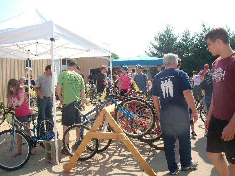 Visitors view the bikes for sale at the Community Used Bike Sale in 2013 hosted by the Champaign Cycle Co. This year will be the fifth annual event and will benefit Habitat for Humanity.