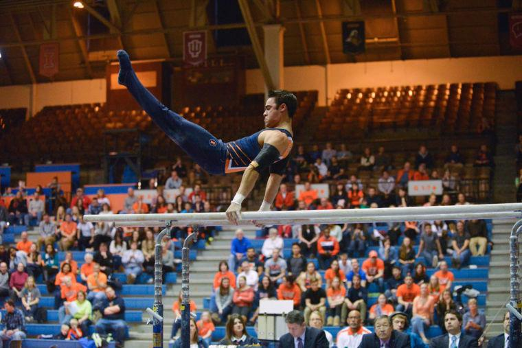 Jordan+Valdez+performs+the+parallel+bars+routine+against+Ohio+State+at+Huff+Hall+on+Sunday%2C+Jan.+26.+In+a+year+filled+with+many+Illini+athletic+disappointments%2C+Valdez%27s+NCAA+title+contributes+to+some+of+the+success+the+Illini+did+experience+in+the+spring.