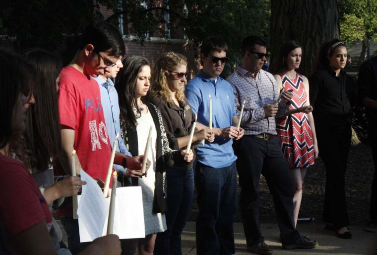Members of Alpha Phi Omega hold candles commemoratingKrzysztof Jablonski's life. Jablonski was an active member in the service fraternity.
