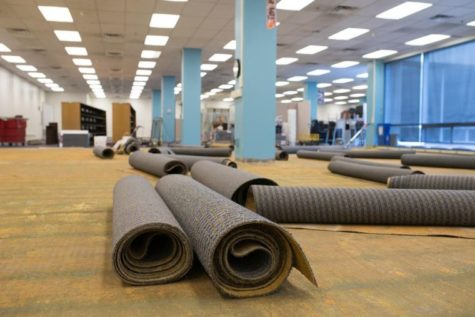 The Undergraduate Library is being recarpeted with tile carpeting, which is easier to clean, before school resumes in the fall.