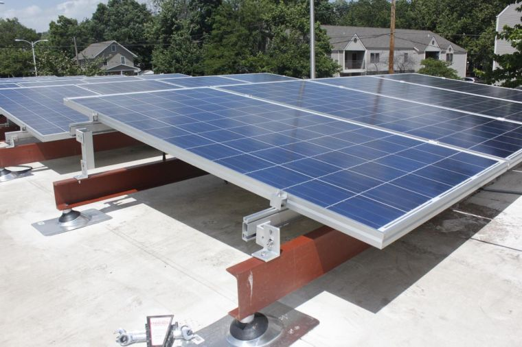 Solar+panels+are+installed+on+the+roof+of+the+First+Mennonite+Church+on+Springfield+Ave.+in+Urbana.