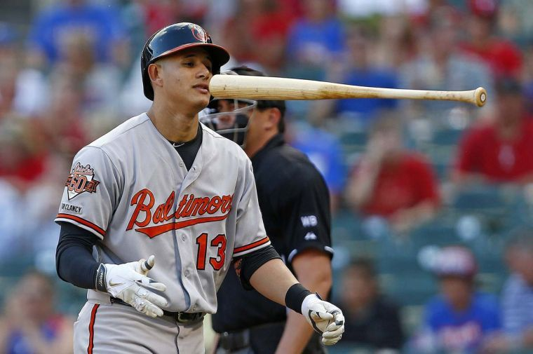 The Baltimore Orioles' Manny Machado reacts after striking out in the first inning against the Texas Rangers on Thursday, June 5, 2014, at Globe Life Park in Arlington, Texas. The Rangers won, 8-6.