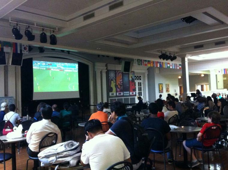 Viewers at the Courtyard Cafe watch as Mexico plays Cameroon during the World Cup. The Cafe screens each game in the cafe for the duration of the tournament.