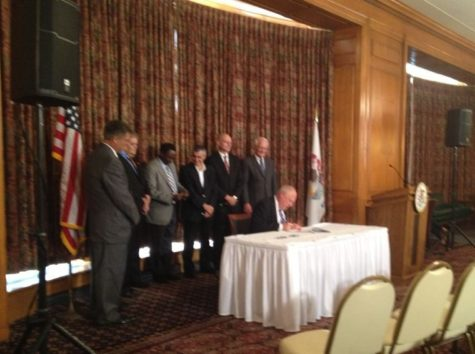 Quinn signs higher education legislation at the Illini Union