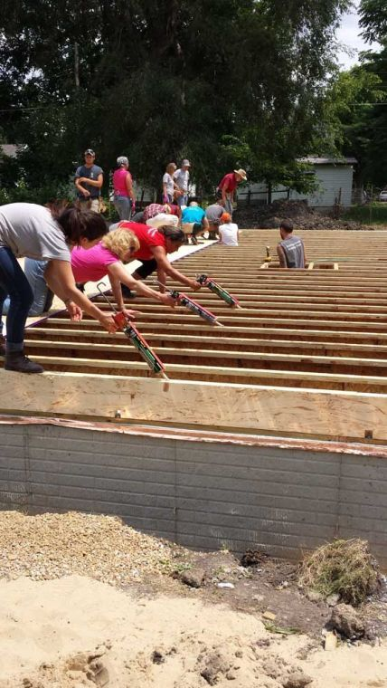 Volunteers at Habitat for Humanity's Angel Build work on the foundation of the home they are building on Saturday. Nine Methodist Churches are teaming up with Habitat in the project.