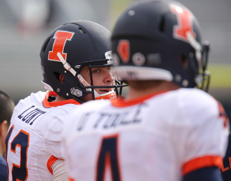Illinois%27+Wes+Lunt+%2812%29+talks+to+Reilly+O%27Toole+%284%29+on+the+sidelines+during+the+annual+Orange+and+Blue+Spring+Game+at+Memorial+Stadium%2C+on+Saturday%2C+April+13%2C+2014.+The+Blue+team+won+38-7.