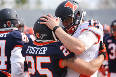 Illinois' Wes Lunt (12) and Kendrick Foster (25) celebrate a touchdown during the annual Orange and Blue Spring Game at Memorial Stadium, on Saturday, April 13, 2014. The Blue team won 38-7.