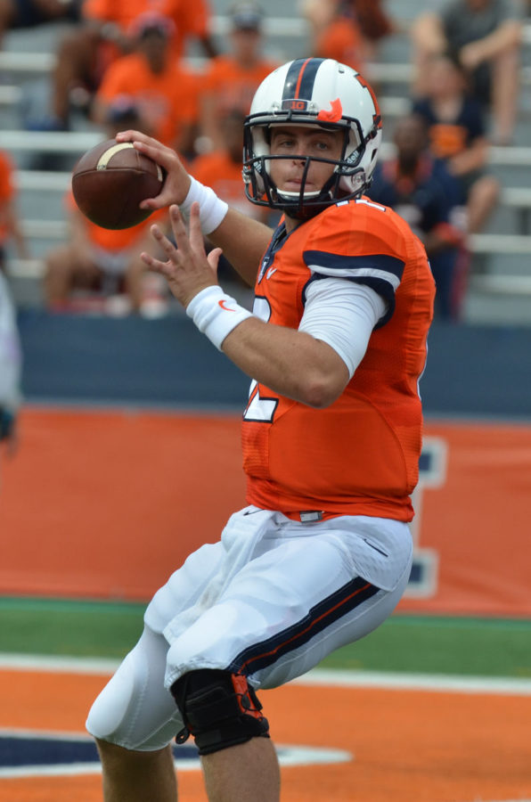 Illinois%27+Wes+Lunt+%2812%29+attempts+to+pass+the+ball+during+the+game+against+Youngstown+State+at+Memorial+Stadium+on+Saturday%2C+Aug.+30%2C+2014.+The+Illini+won+28-17.