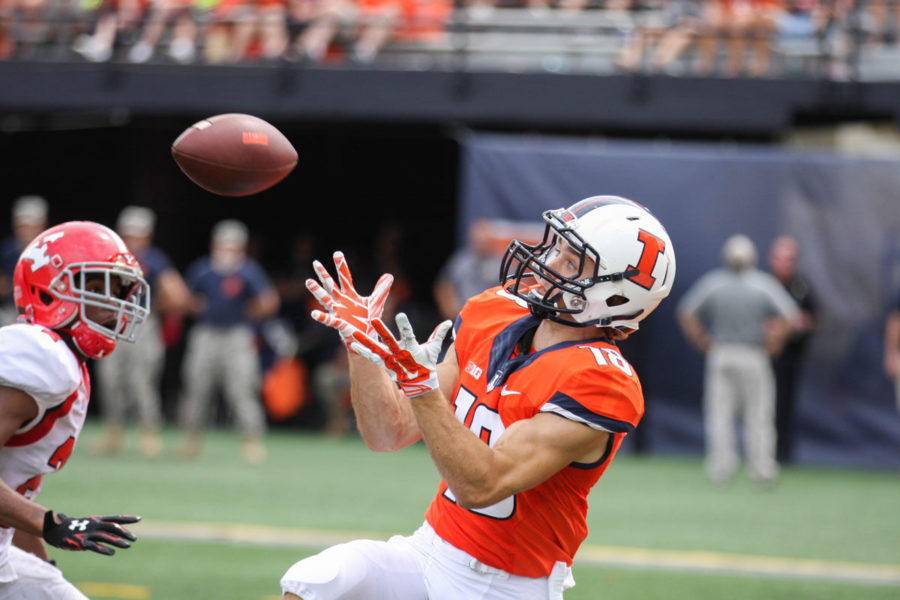 Illinois%27+Mike+Dudek+attempts+to+catch+a+pass+during+the+Illinois+v.+Youngstown+State+football+game+at+Memorial+Stadium+on+Saturday.+Mike%E2%80%99s+older+brother%2C+Danny%2C+watched+from+the+bleachers.%C2%A0