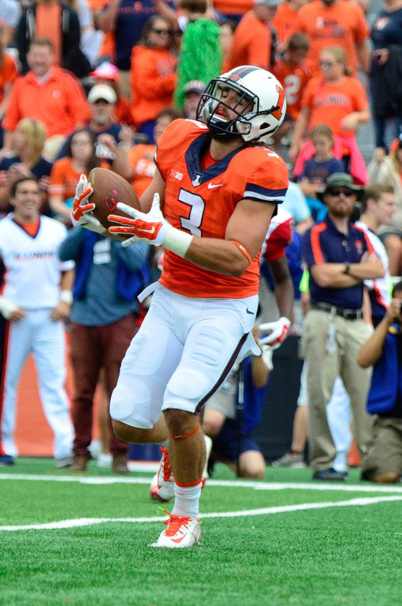 Illinois' Taylor Barton intercepts a Western Kentucky pass for a 77-yard touchdown at Memorial Stadium on Saturday.The Illini won 42-34.