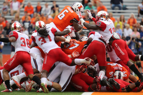 Running back Josh Ferguson puts Illinois on the board first with a touchdown in the first quarter against Western Kentucky at Memorial Stadium on Saturday. The Illini won 42-34.
