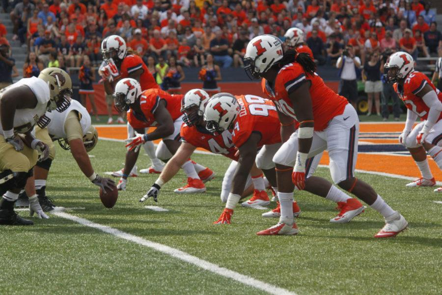 Illinois' defensive line gets in to position during the game against Texas State on Saturday. This weekend the defensive line will have to stay on their toes to keep Nebraska's Ameer Abdullah in check.