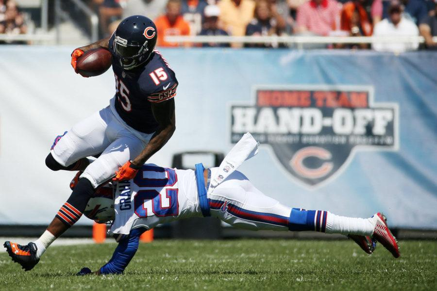 Chicago Bears wide receiver Brandon Marshall (15) moves around Buffalo Bills cornerback Corey Graham (20) as he runs with the ball during the first quarter on Sunday.
