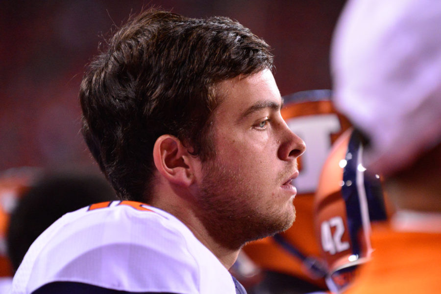 Illinois' Wes Lunt watches from the sidelines while sitting out due to a sprained knee injury during the game against Nebraska at Memorial Stadium in Lincoln, Neb. on Saturday. The Illini lost 45-14.