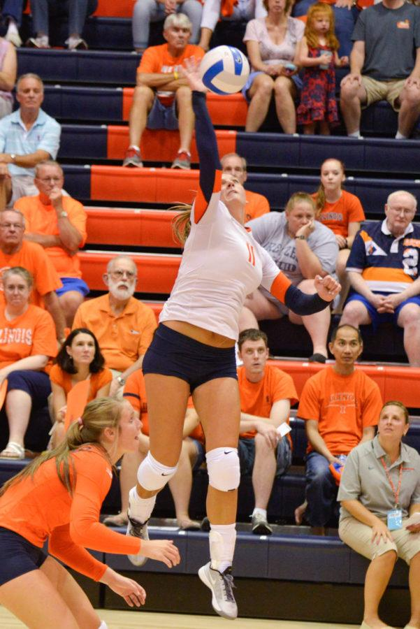 Illinois%27+outside+hitter+Katie+Roustio+%2811%29+attacks+the+ball+during+the+Alumni+Match+on+Saturday%2C+Aug.+23.+The+orange+and+blue+teams+tied+2-2.