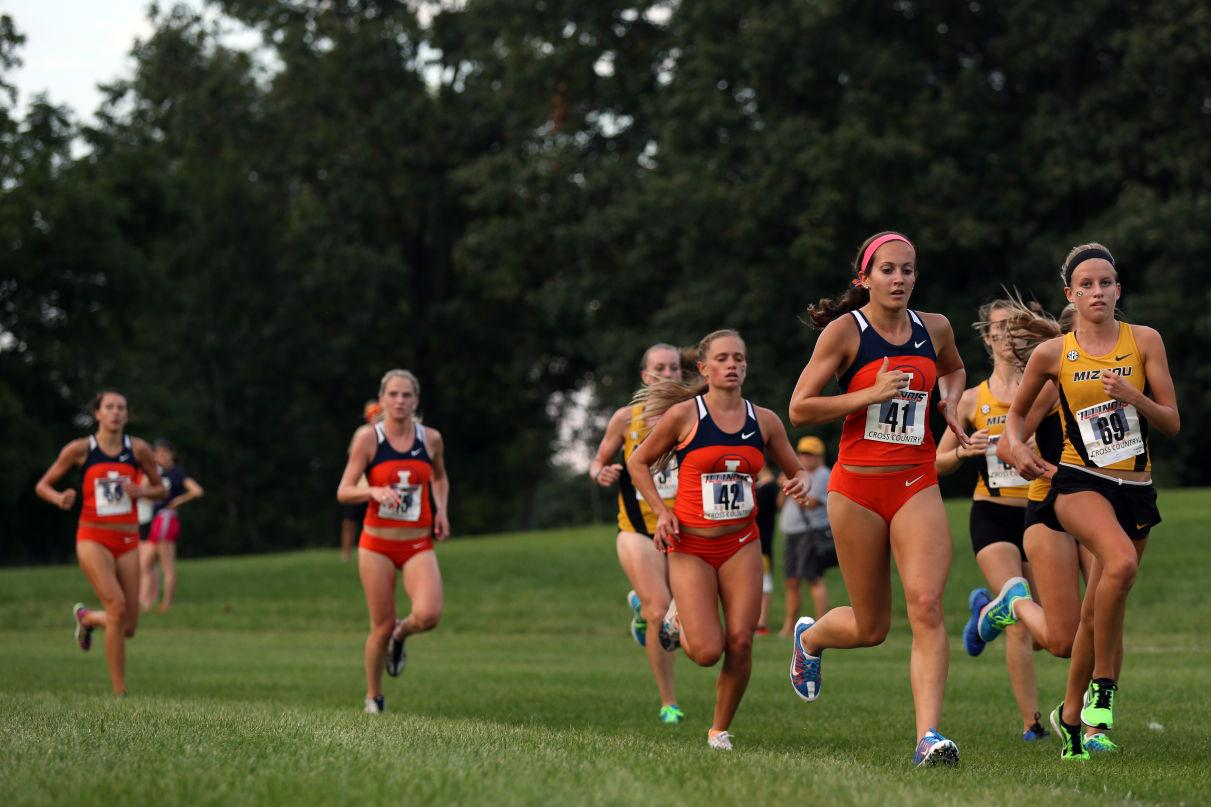 Members of the Fighting Illini women's track and cross country team run the second lap of the course during the Illini Challenge at the UI Arboretum on Friday, Aug. 29, 2014. The women's cross country placed second with a combined total of 31 points.