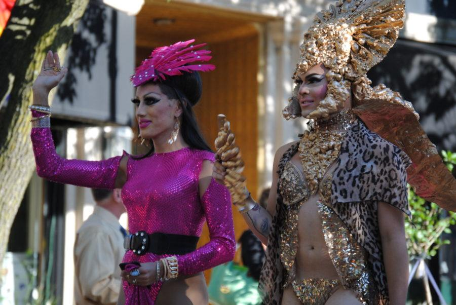 Pride parade participants march down Neil Street.
