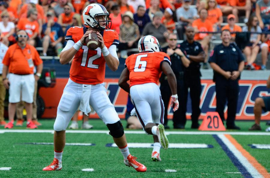 Illinois%27+Wes+Lunt+%2812%29+looks+to+pass+the+ball+during+the+game+against+Texas+State+at+Memorial+Stadium+on+Saturday%2C+Sept.+20.+The+Illini+won+42-35.