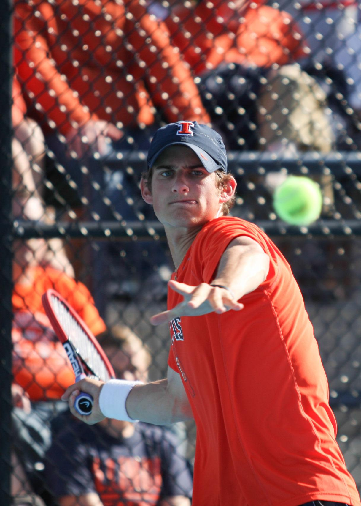Illinois' Jared Hiltzik hits the ball back during the second round of NCAA Tennis Regionals against the University of Memphis at Khan Outdoor Tennis Complex on May 10.