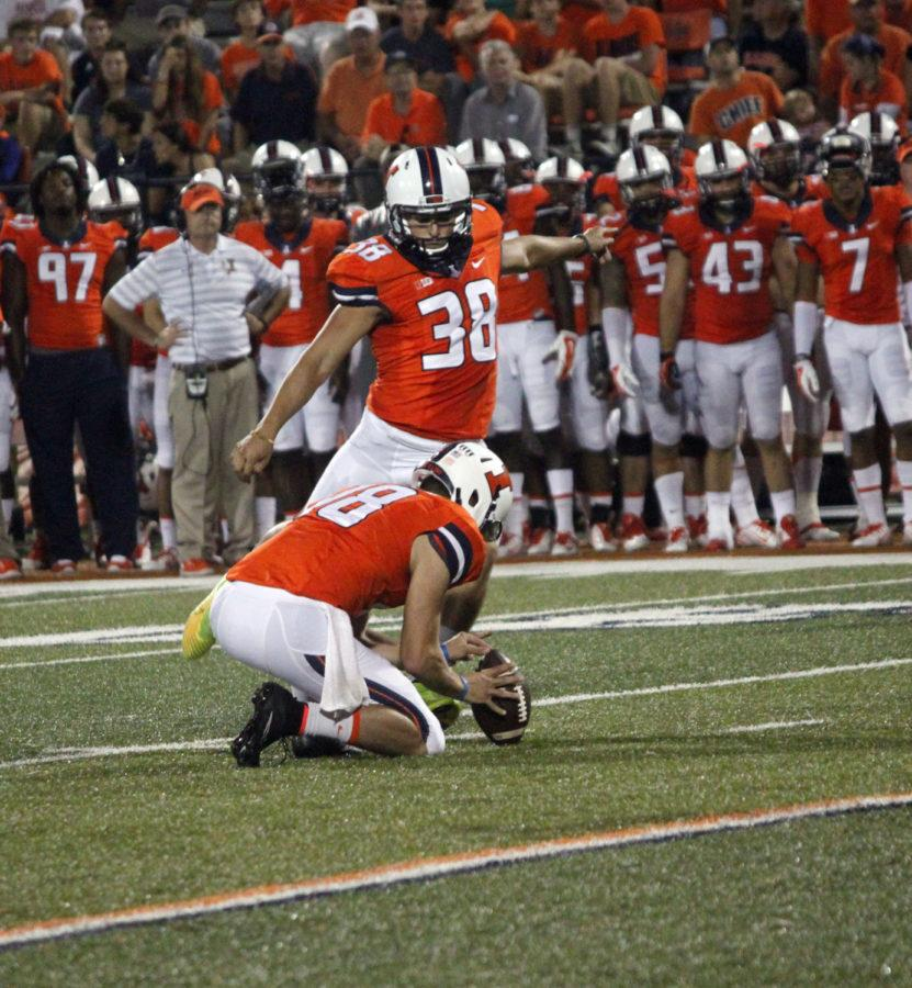 Illinois%27+David+Reisner+kicks+the+ball+during+the+game+against+Texas+State+at+Memorial+Stadium+on+Saturday%2C+Sept.+20%2C+2014.+Illinois+won+42-35.