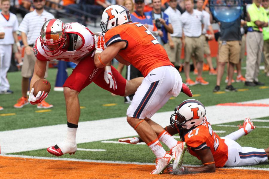 Illinois%E2%80%99+Taylor+Barton+%283%29+attempts+to+stop+a+Western+Kentucky+touchdown+during+the+game+at+Memorial+Stadium+on+Saturday.+Barton+later+intercepted+a+pass+and+returned+it+for+a+touchdown.