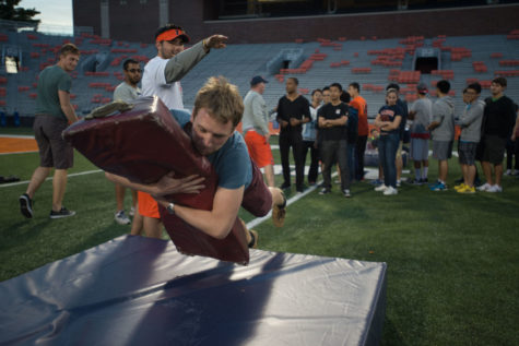 David Grömling, senior in engineering and exchange student, performs a tackling drill. University students from all around the world gathered at Memorial Stadium on Wednesday to learn about American football, which was taught by Coach Tim Beckman and the football coaching staff.