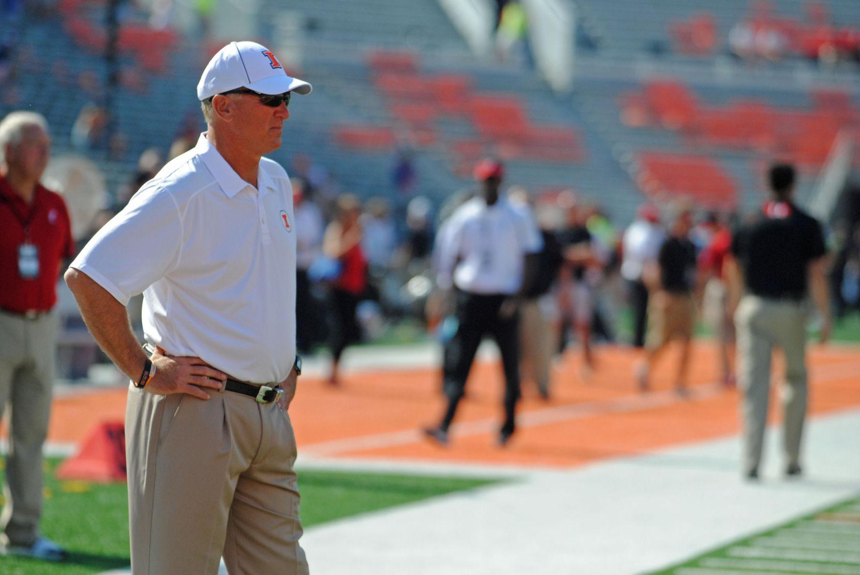 Offensive Coordinator Bill Cubit watches his team warm up against Cincinnati on Sept. 7, 2013.