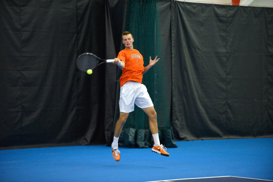 Illinois' Brian Page returns the ball against No. 8 Texas at Atkins Tennis Center on Feb. 9. Page is one of two Illini attending the Crimson Tide Four-in-the-Fall this weekend.