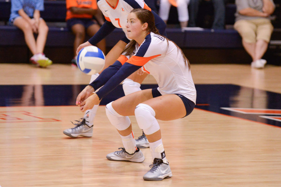 Illinois' outside hitter Ali Stark (13) bumps the ball during the Alumni Match on Aug. 23, 2014.