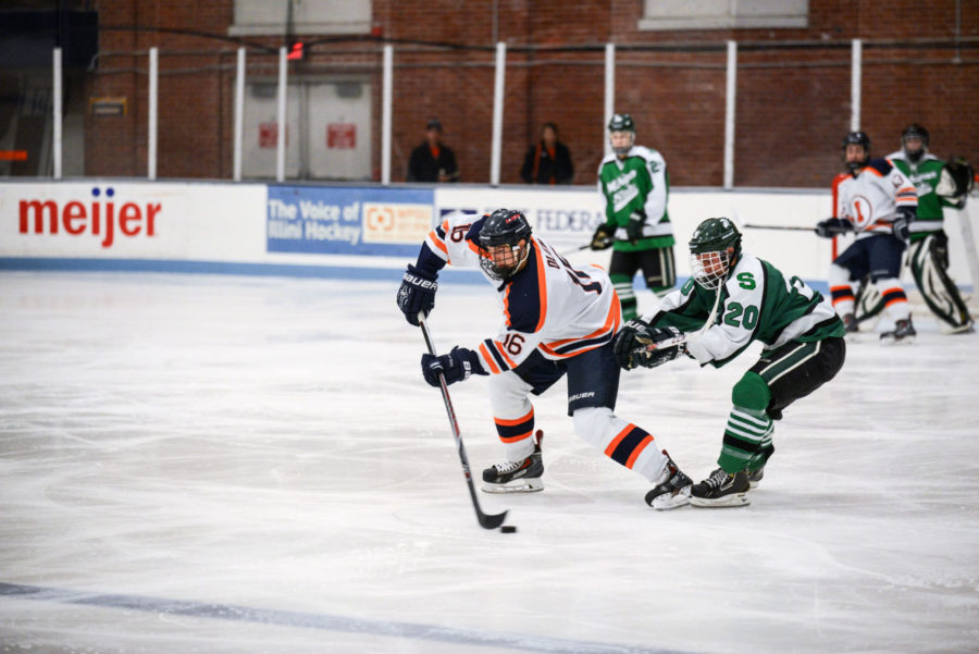 Illinois' John Olen (16) intercepts the puck at the Illinois Ice Arena on Sept. 27. He leads the team in points, but will not play on Friday.
