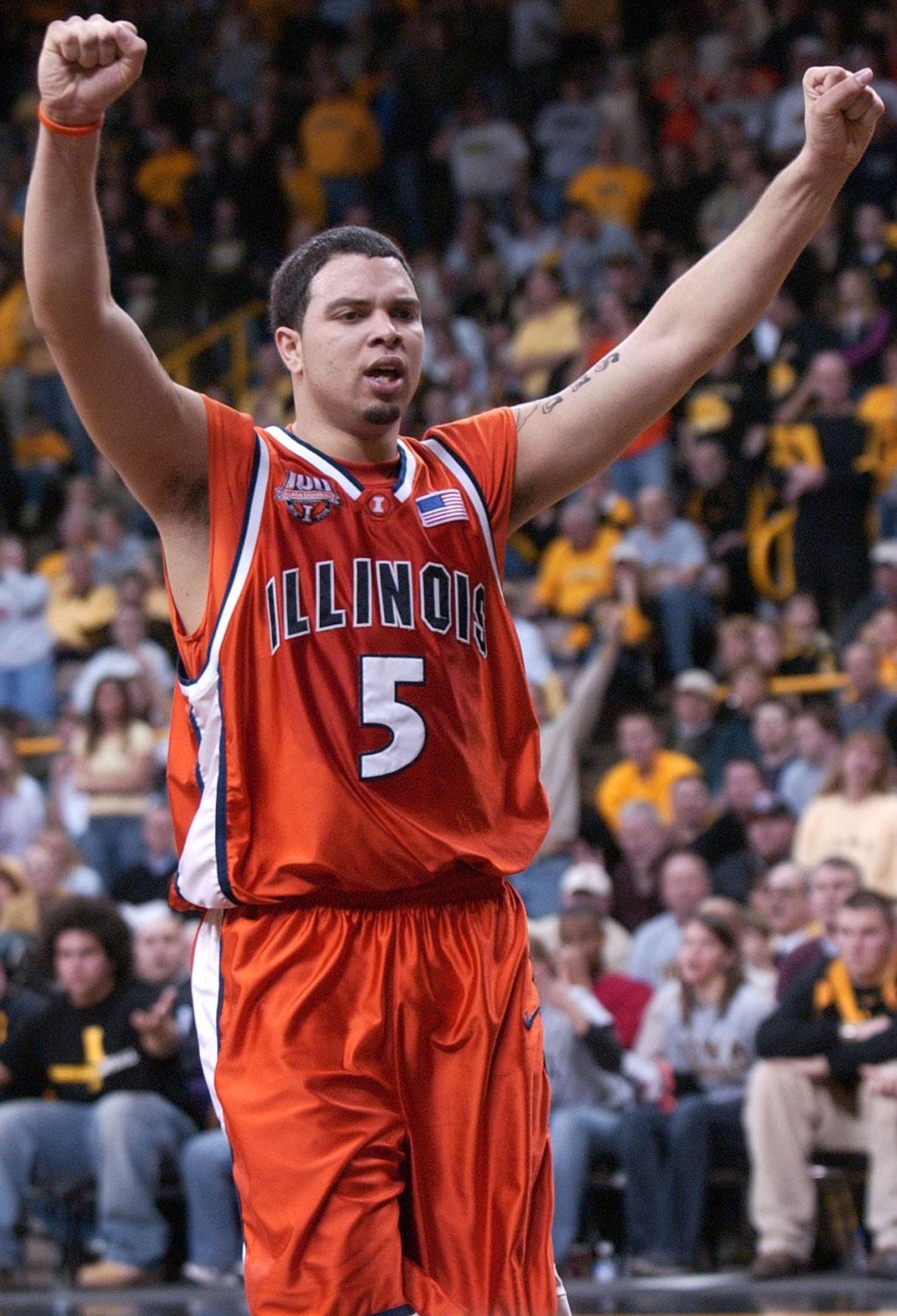 Illinois' Deron Williams raises his arms to celebrate points scored by teammate Dee Brown during the second half of the game at the University of Iowa on Feb. 11, 2005.