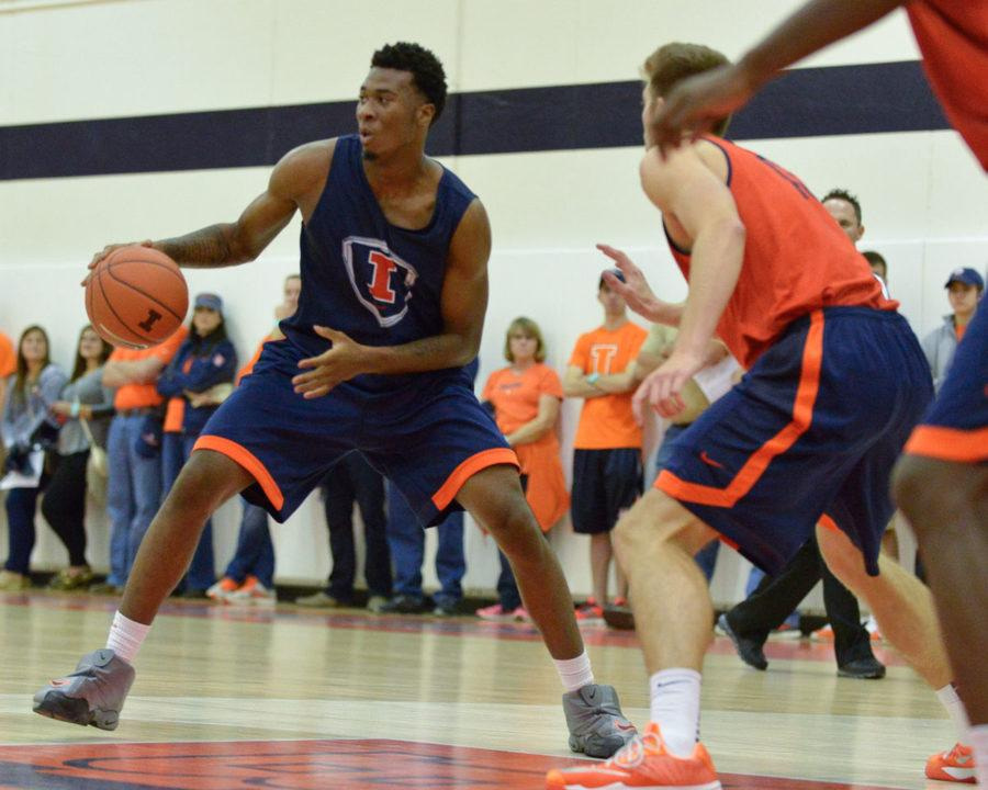 Illinois' Leron Black looks for an open pass during the