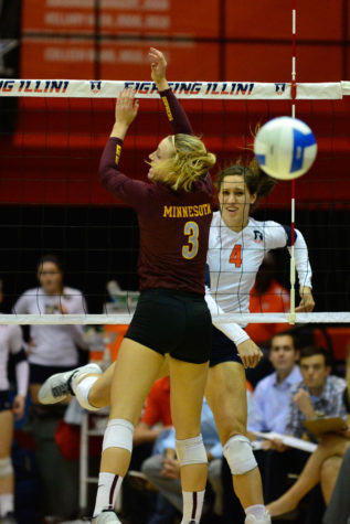 Illinois' Michelle Strizak watches on after spiking the ball during the game against Minnesota at Huff Hall, on Wednesday, Oct. 1, 2014. The Illini won 3-0.