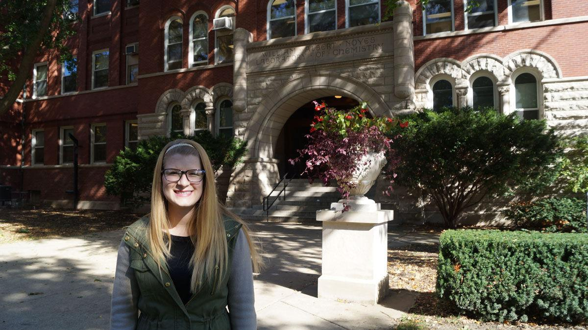 REACT Program staff member, Emilee Nawa, stands in front of the Noyes Laboratory on Tuesday, Oct. 21, 2014.