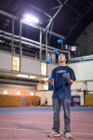 Raymond Li, senior in Engineering, practices juggling on the Armory's indoor track on October 6th, 2014.