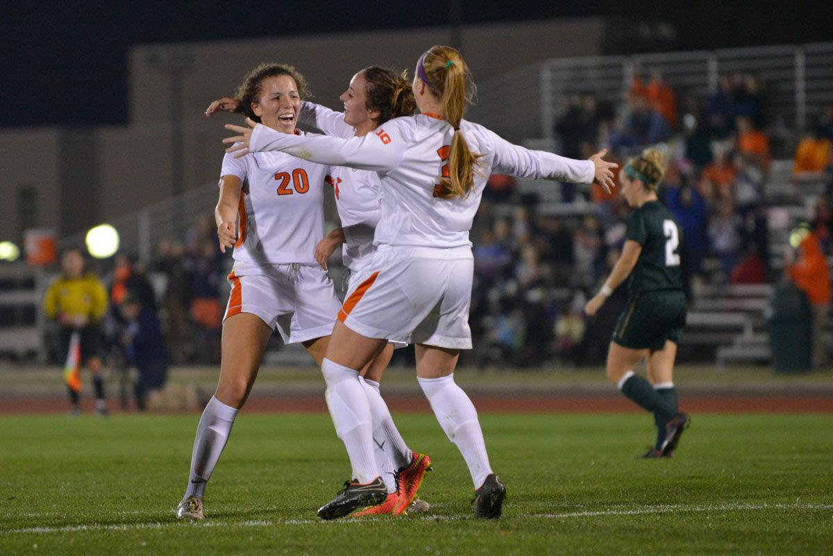 Illinois forward Kara Marbury (20) is congratulated by her teammates after scoring one of the two goals to win against Michigan State at Illinois Track and Soccer Stadium on Friday.