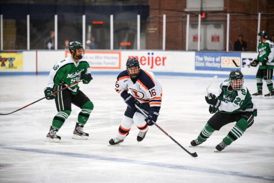 Illinois' John Olen races toward the puck in the game against Michigan State on Sept. 27.