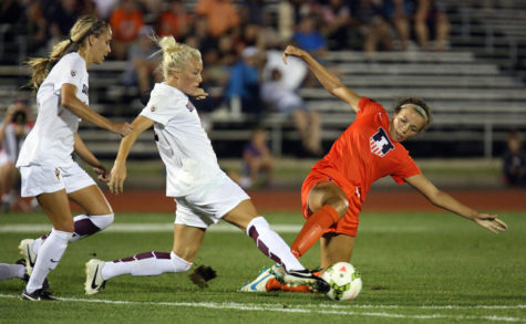 Illinois' Kara Marbury (20) slides in an attempt to retina possession during the game against Arizona State at the Illinois track and soccer stadium on August, 29, 2014. The Illini won 3-1.