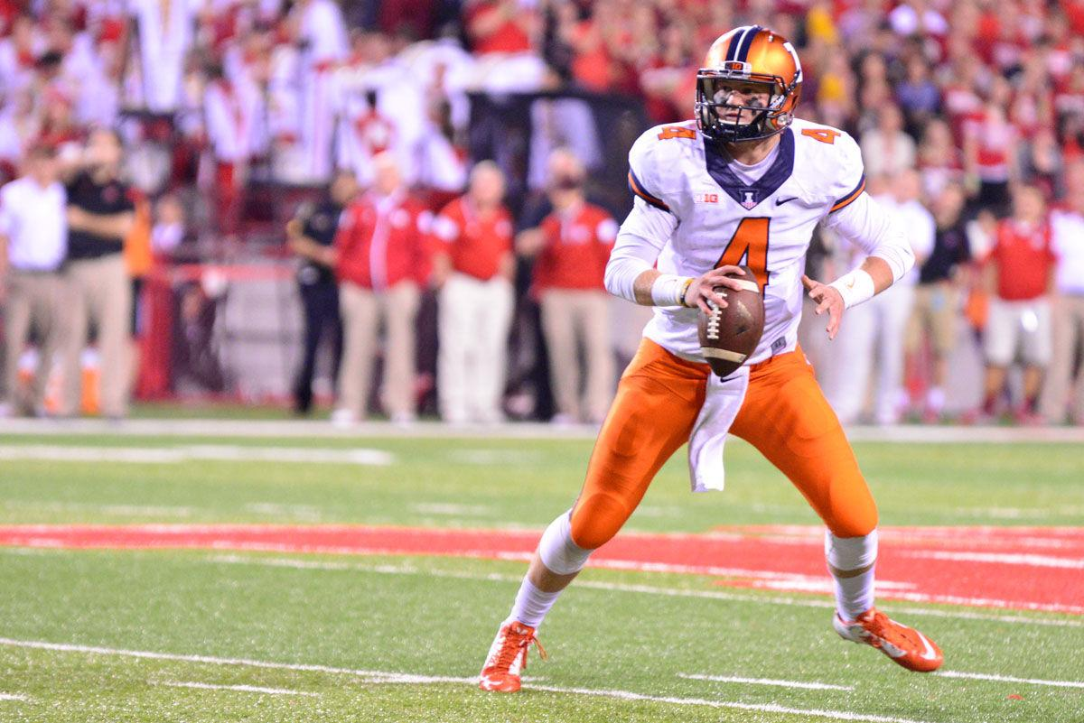 Illinois' Reilly O'Toole (4) attempts to pass the ball during the game against Nebraska at Memorial Stadium in Lincoln, Neb. on Sept. 27. The Illini lost 45-14.