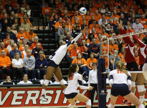 Illinois' Morganne Criswell tips the ball over the net during the game against Wisconsin on Saturday.