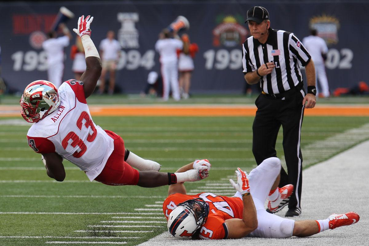 Illinois%27+Mason+Monheim+%2843%29+tackles+Western+Kentucky%27s+Leon+Allen+%2833%29+during+the+game+against+Western+Kentucky+at+Memorial+Stadium+on+Sept.+6.