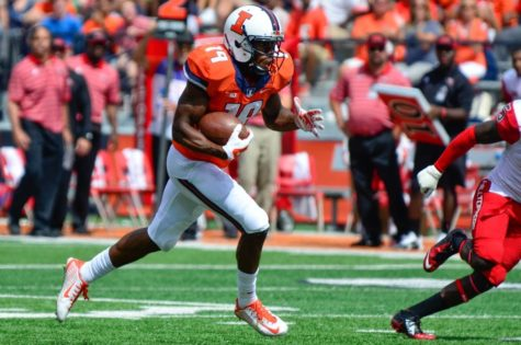 Illinois' Justin Hardee (19) runs for a touchdown during the game against Western Kentucky at Memorial Stadium on Sept. 6.